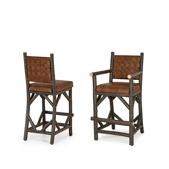 Rustic Bar Stool #1384 & Bar Stool w/Arms #1386 w/Woven Leather Back shown in Ebony Premium Finish (on Bark)