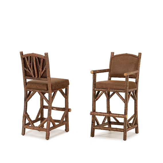 Rustic Bar Stool #1394 & Bar Stool w/Arms #1396 w/Tight Upholstered Back shown in Natural Finish (on Bark)
