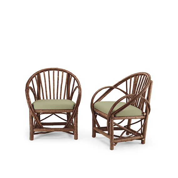 Rustic Arm Chair #1052 shown in Natural Finish (on Bark)
