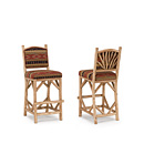 Barstool #1394 w/Tight Upholstered Back shown in Pecan Premium Finish (on Peeled Bark) La Lune Collection