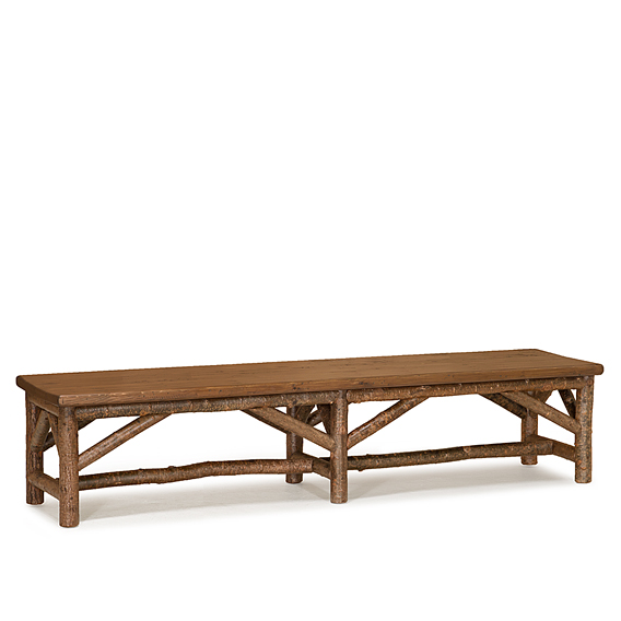 Rustic Bench #1528 shown in Natural Finish (on Bark)