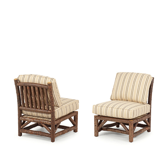 Rustic Armless Club Chair #1172 shown in Natural Finish (on Bark)