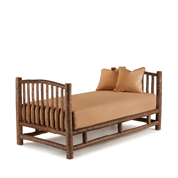 Rustic Daybed #4016 shown in Natural Finish (on Bark)