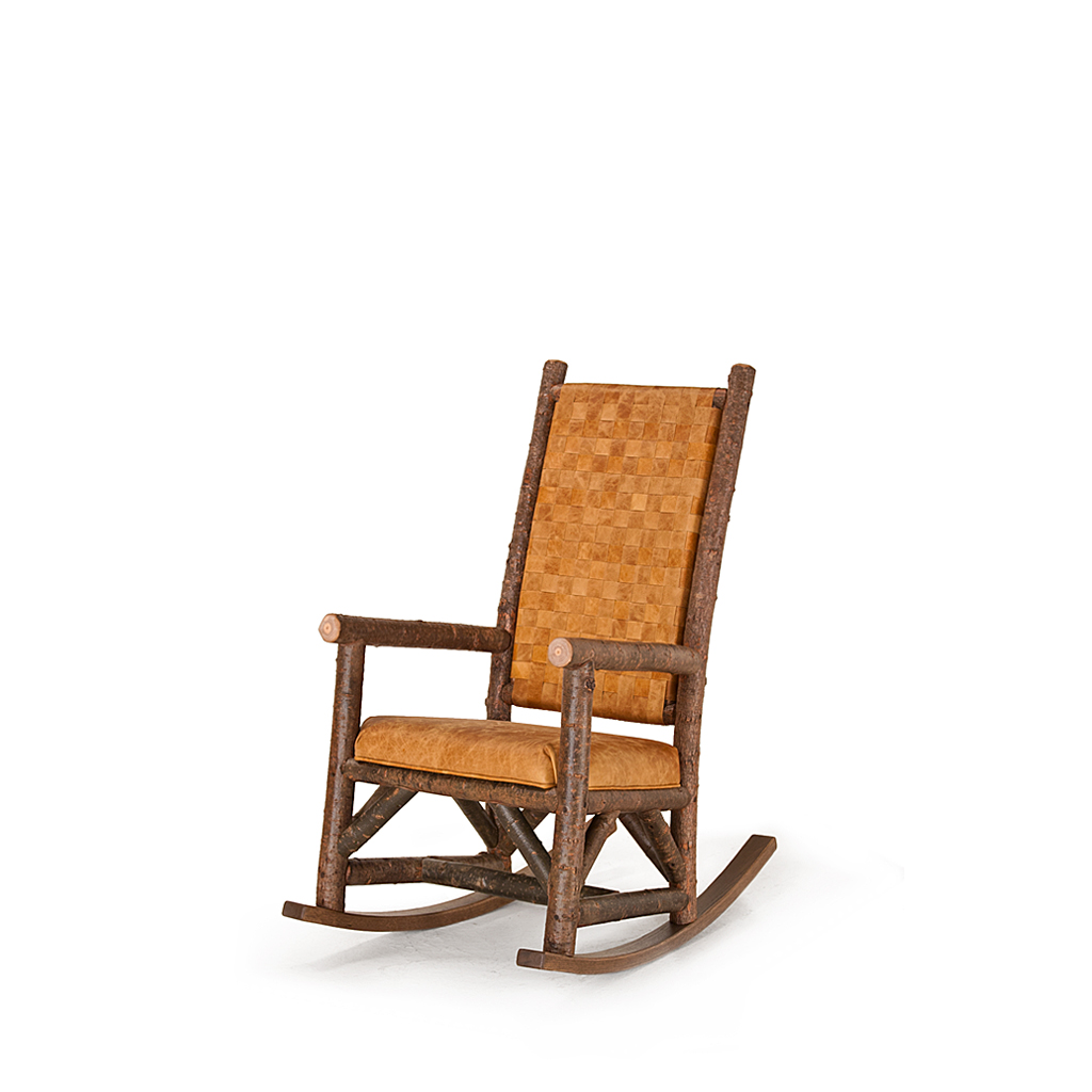 Rustic Rocking Chair With Woven Leather Back 1188 Shown In Natural Finish On Bark