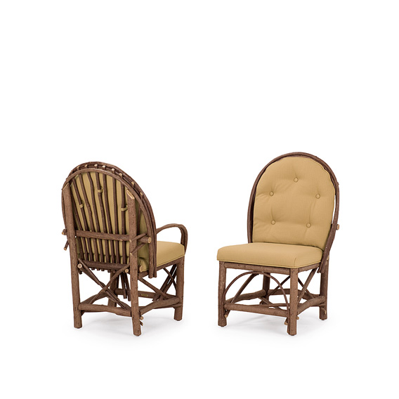 Rustic Dining Arm Chair with Tie-On Back Pad #1078 & Dining Side Chair with Tie-On Back Pad #1076 shown in Natural Finish (on Bark)