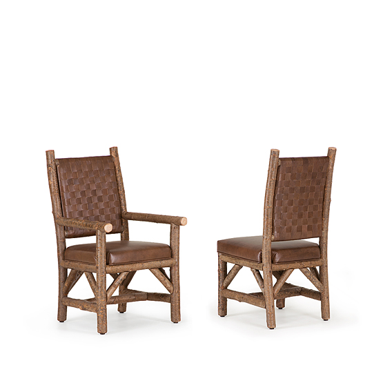 Rustic Arm Chair #1186 & Side Chair #1184 with Woven Leather Backs shown in Natural Finish (on Bark)