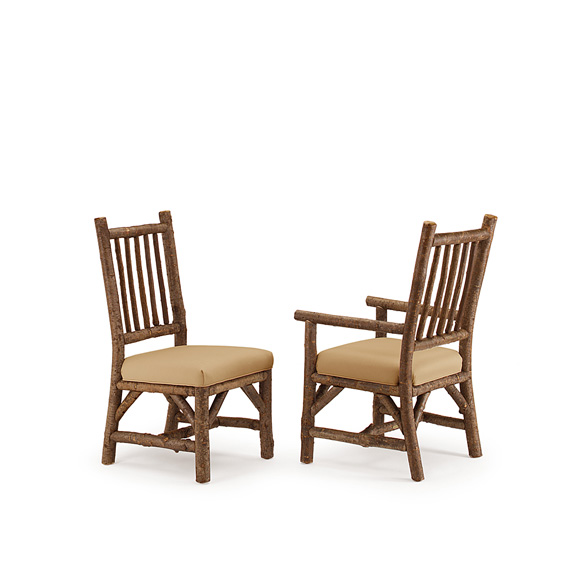 Rustic Dining Side Chair #1204 & Dining Arm Chair #1206 shown in Natural Finish (on Bark)