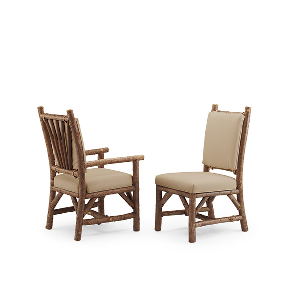 Rustic Dining Side Chair #1208 & Dining Arm Chair #1210 with Tie-on Back Pads shown in Natural Finish (on Bark)