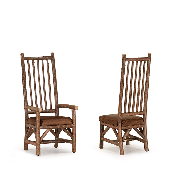 Rustic Dining Arm Chair #1214 & Dining Side Chair #1212 shown in Natural Finish (on Bark)