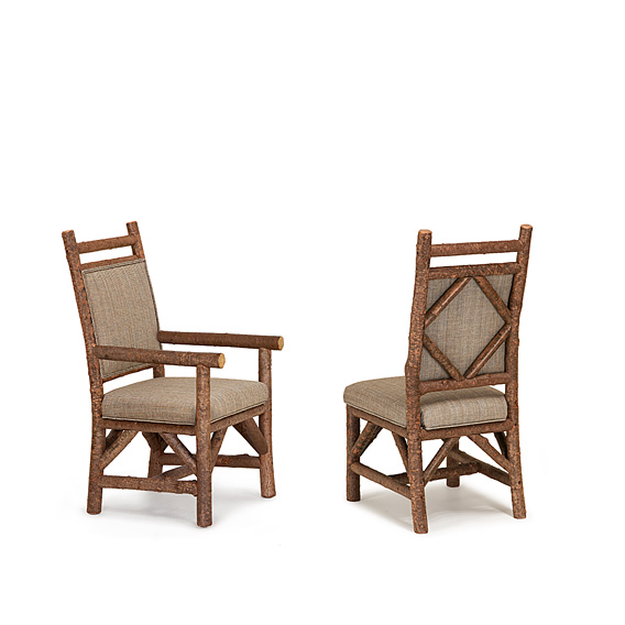 Rustic Dining Arm Chair #1295 & Dining Side Chair #1294 w/Tight Upholstered Back shown in Natural Finish (on Bark)
