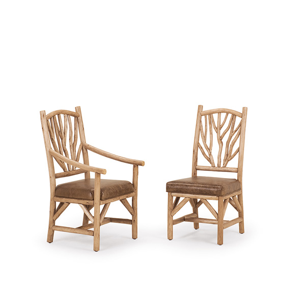 Rustic Dining Arm Chair #1402 & Dining Side Chair #1400 shown in Pecan Premium Finish (on Peeled Bark)