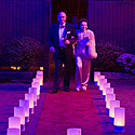 Gala guests arrive on luminaria-lined red carpet path