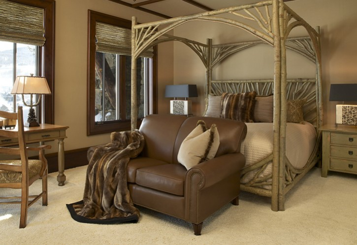 rustic canopy bed in a Billy Beson Ski Resort Bedroom