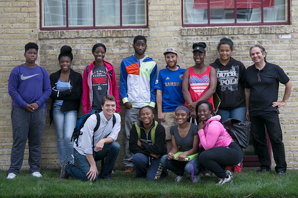 Teens and tour director pose for a group photo at tour's end.